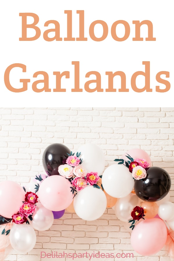 Pretty Balloon Garland with different size balloons and colors and some flowers