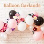 Pretty Balloon Garland with flowers, brick wall behind