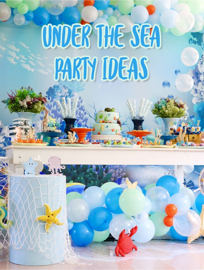 Under The Sea Party Ideas with balloon Garland, netting and grazing table
