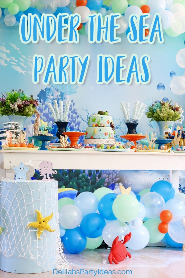 Under The Sea Party Ideas with balloon Garland, netting and grazing table.