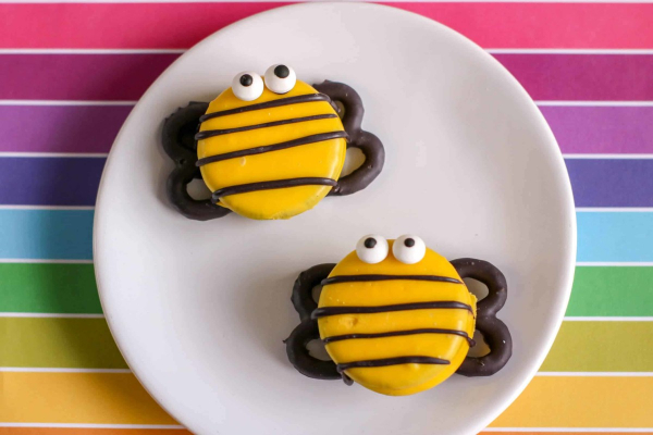 Plate with 2 homemade bumble bee cookies on it