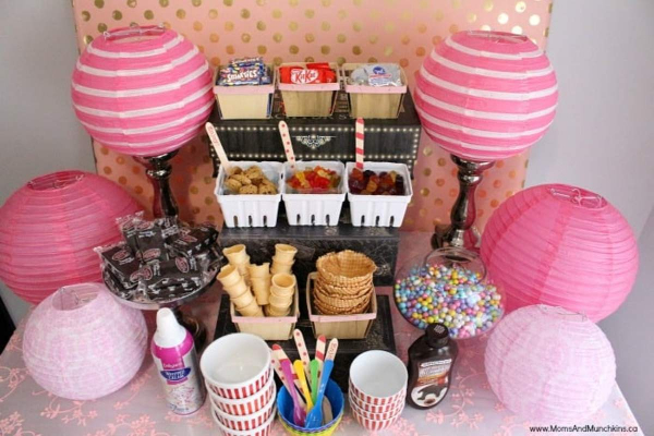 ice cream buffet bar with lollies, cones, sweets, spoons and bowls