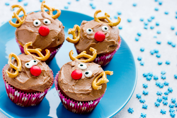 Blue plate with 4 cupcakes that look like Rudolph the red nosed reindeer