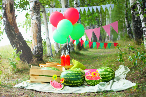 Watermelon decorations in the garden, balloons, drinks, flag banners