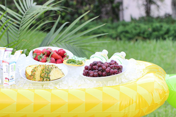 blow up pool pineapple with ice and fruit as a hydration station
