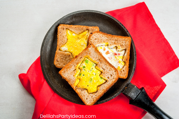 Kids Christmas Toast with scrambled eggs in the middle shaped like Christmas tree and a star