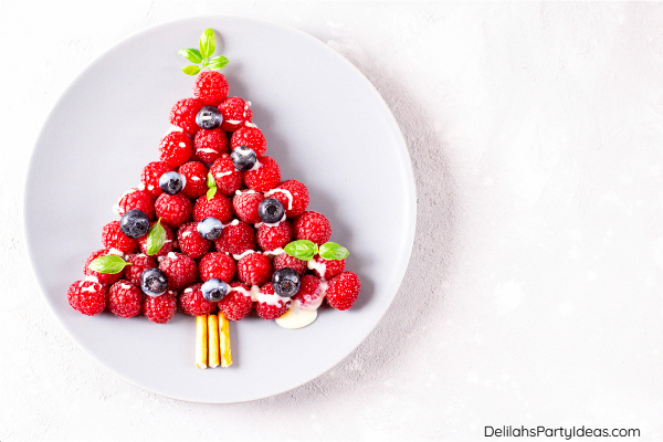 Strawberry and raspberry Christmas tree on a plate
