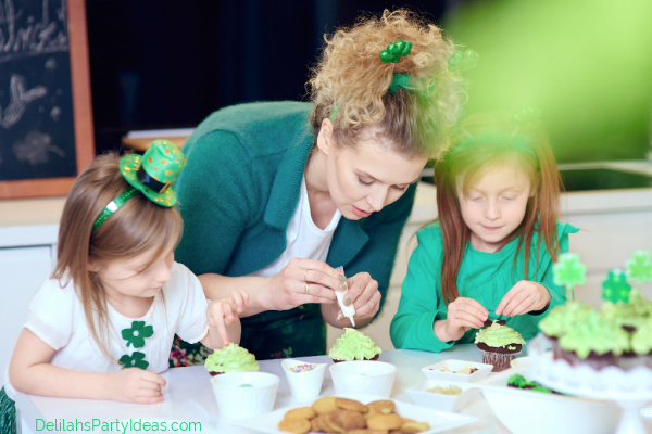 Family preparing cupcakes at Saint Patrick's Day