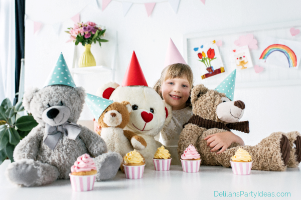 Teddy Bear Tea Party With Cupcakes and little girl